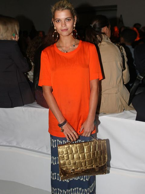 """<p><a href=""""http://www.elleuk.com/starstyle/style-files/(section)/Pixie-Geldof"""">Pixie Geldof</a> carrying a metallic satchel at the <a href=""""http://www.elleuk.com/catwalk/collections/house-of-holland/"""">House of Holland</a> show during London Fashion Week,"""