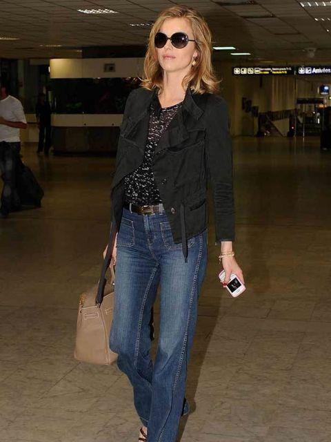 "<p><a href=""http://www.elleuk.com/content/search?SearchText=eva+herzigova&SearchButton=Search"">Eva Herzigova</a> wearing <a href=""http://www.elleuk.com/style/street-style/kick-flare-jeans"">flared jeans</a> and a <a href=""http://www.elleuk.com/catwalk/"