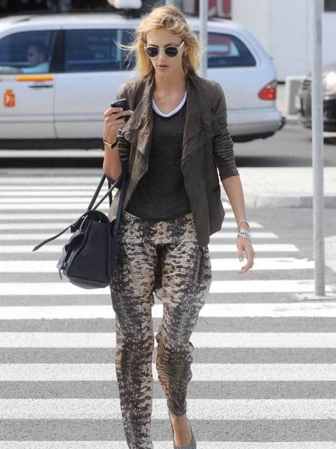 """<p><a href=""""http://www.elleuk.com/content/search?SearchText=Anja+Rubik&SearchButton=Search"""">Anja Rubik</a> looking chic in a khaki jacket, <a href=""""http://www.elleuk.com/style/street-style/printed-trousers"""">printed trousers</a> and <a href=""""http://www"""