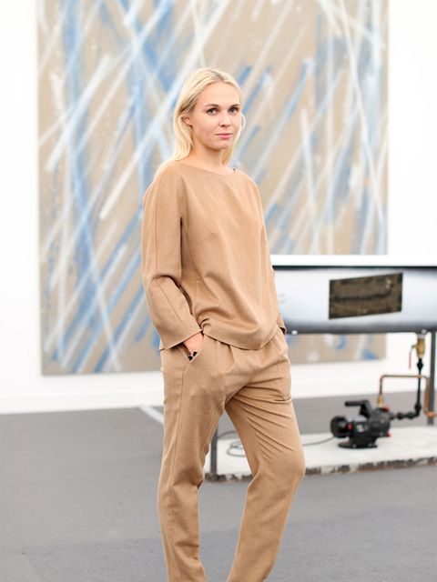 Victoria Latysheva wears Max Mara top and trousers, Zara shoes.