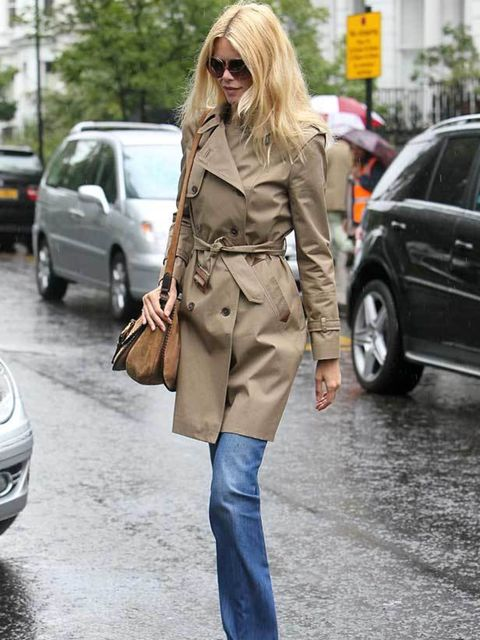 "<p><a href=""http://www.elleuk.com/content/search?SearchText=Claudia+Schiffer&SearchButton=Search"">Claudia Schiffer</a> pairing her trench coat with <a href=""http://www.elleuk.com/style/street-style/kick-flare-jeans"">flared jeans</a> while on the schoo"