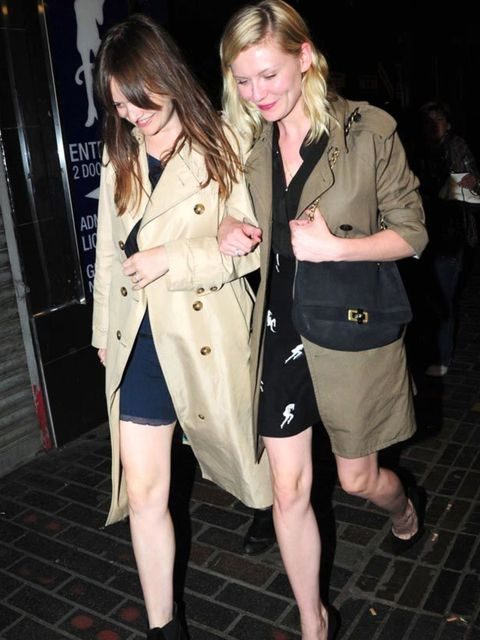 "<p><a href=""http://www.elleuk.com/starstyle/style-files/(section)/kirsten-dunst"">Kirsten Dunst</a> teaming a trench coat with <a href=""http://www.elleuk.com/catwalk/collections/miu-miu/"">Miu Miu</a> dress, <a href=""http://www.elleuk.com/catwalk/collection"