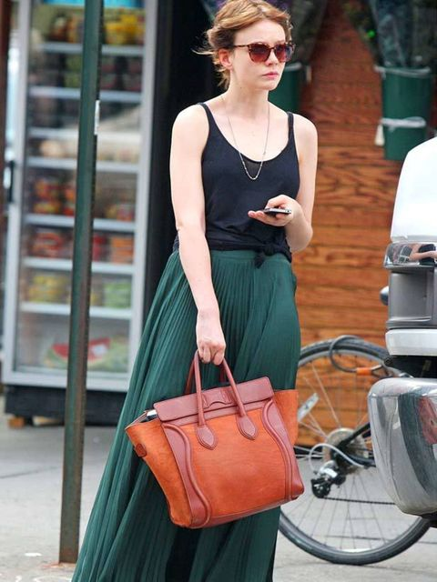 "<p><a href=""http://www.elleuk.com/starstyle/style-files/(section)/carey-mulligan"">Carey Mulligan</a> colour-blocking a green pleaated maxi skirt and <a href=""http://www.elleuk.com/catwalk/collections/celine"">Celine</a> bag</p>"