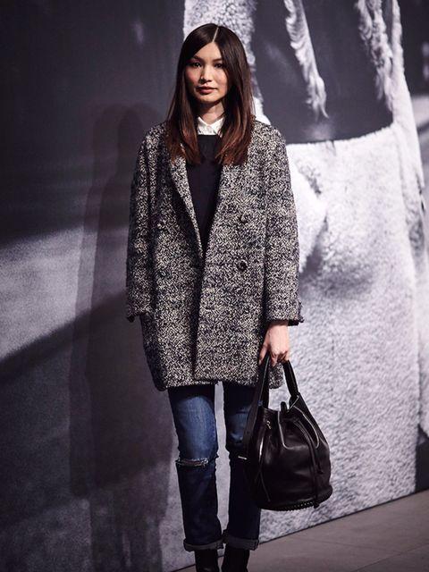 Gemma Chan carrying AllSaints bag at the London Fashion Week.