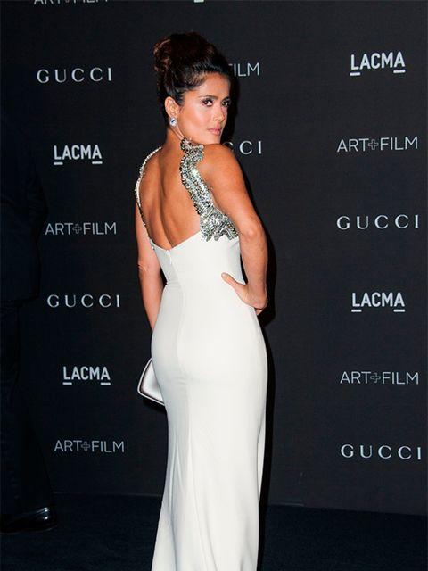 <p>Salma Hayek Pinault wears a Gucci custom-made ivory silk dress to the LACMA Art + Film Gala, November 2014.</p>