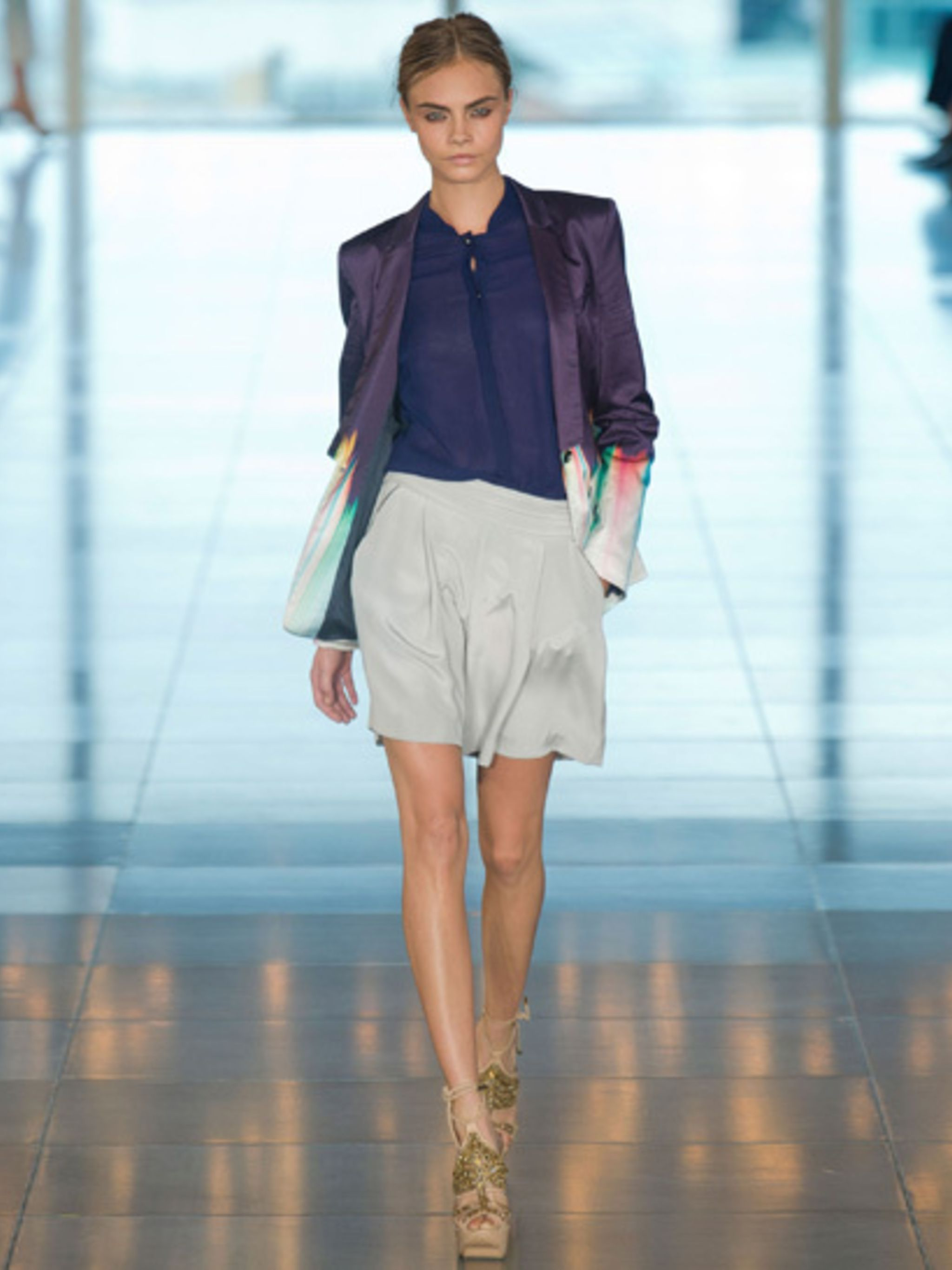 <p>A model takes to the catwalk at the Matthew Williamson SS13 show</p>