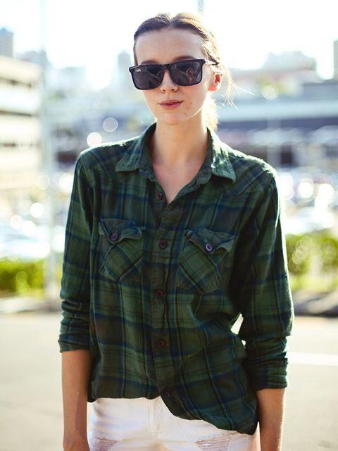 <p>Hannah wears a NastyGal vintage shirt, Bing Harris & Co shorts and Le Specs sunglasses.</p>
