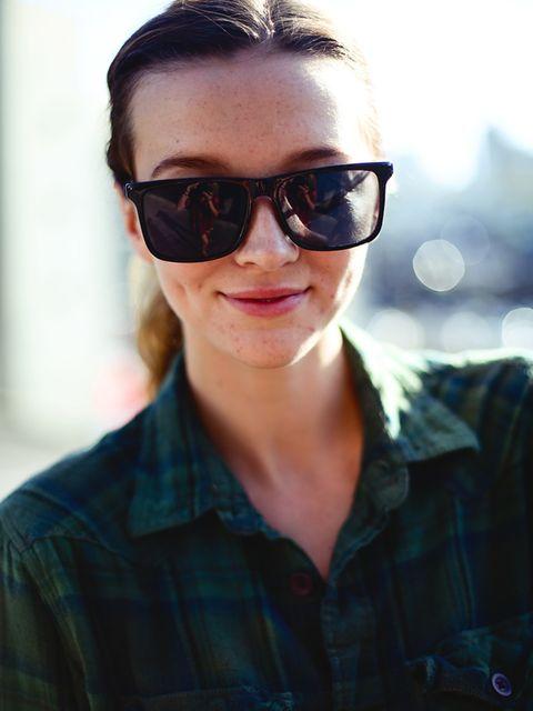 <p>Hannah wears a NastyGal vintage shirt and Le Specs sunglasses.</p>