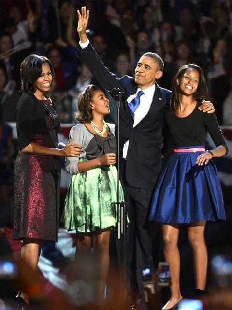 <p>Michelle Obama celebrates President Obama's victory in Michael Kors</p>