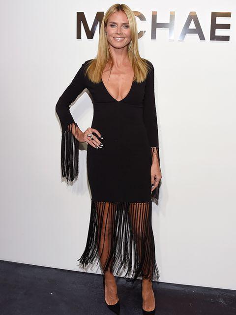 Heidi Klum attends the Michael Kors ss 2015 show for New York Fashion Week wearing a Michael Kors fringed dress, September 2014.