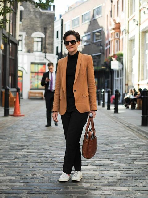 Lotte Jeffs , Deputy Editor Zara blazer, Topshop poloneck, Phillip Lim trousers, Comme Des Garcons shoes,, Ray Ban sunglasses, briefcase from a shop in Antwerp