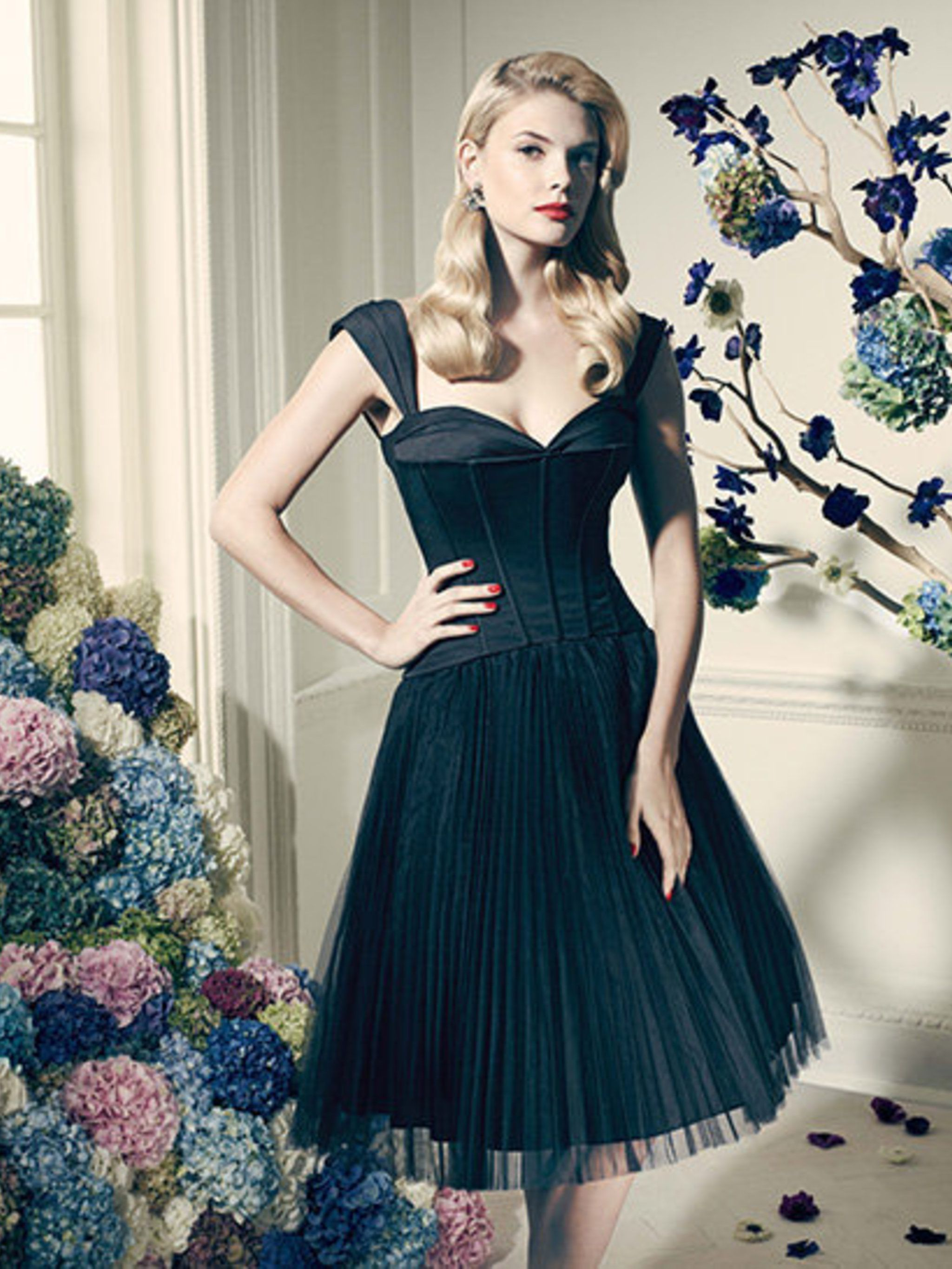 <p>Corset Inspired Satin Bodice over a skirt of layered, pleated net, £175.</p>
