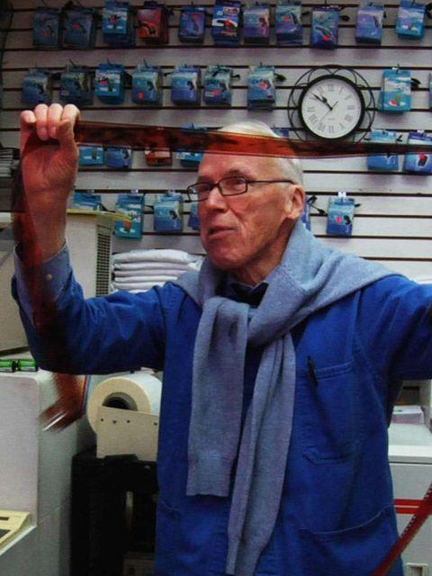 <p>Bill Cunningham, who still shoots film, inspects his negatives.</p>