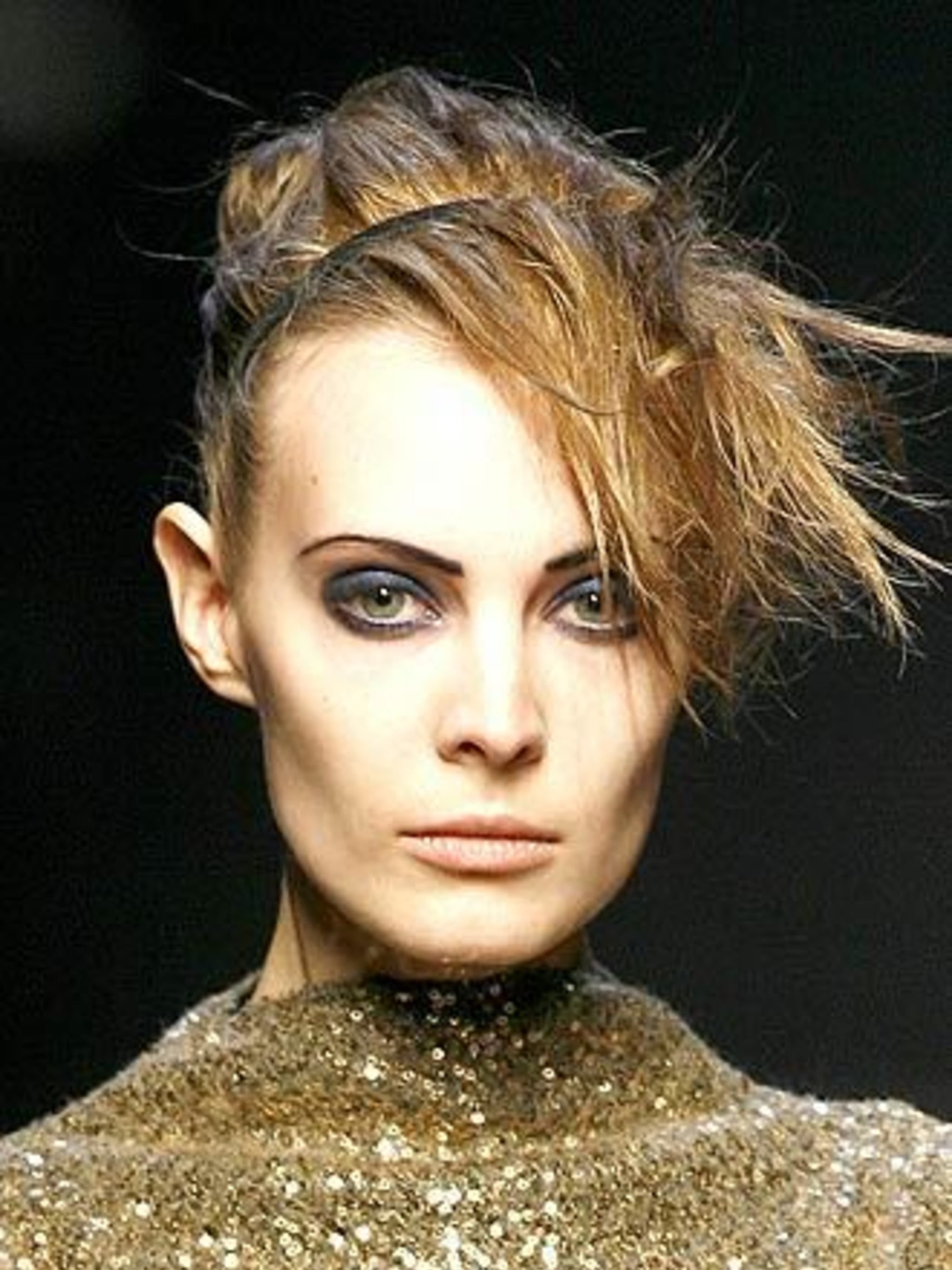<p>Jewel eyesGemstones and precious metals inspired a host of different looks backstage this season. At Costume National CNC make-up artist Sally Branka injected elegance into a punky 'club kid' look with wet-look sapphire eyes, while at Prada an austere