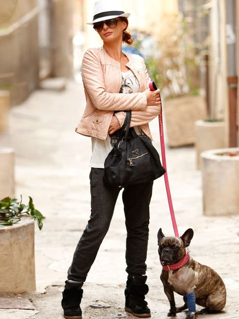 <p>Vanessa (with Chanel the dog), Estate Agent. Zara jacket and t-shirt, Isabel Marant sneakers, Prada bag, hat from St Tropez.</p><p>Photo by Anthea Simms</p>
