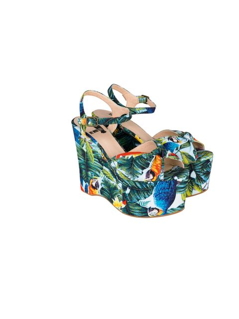 "<p>Urban Outfitters parrot print wedges, £75</p><p><a href=""http://shopping.elleuk.com/browse?fts=urban+outfitters+parrot"">BUY NOW</a></p>"