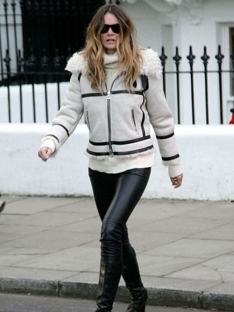 """<p>Elle Macpherson wears an <a href=""""http://www.elleuk.com/catwalk/collections/isabel-marant/spring-summer-2011/collection"""">Isabel Marant</a> shearling suede jacket and boots for the school run, 25 November 2010 </p>"""