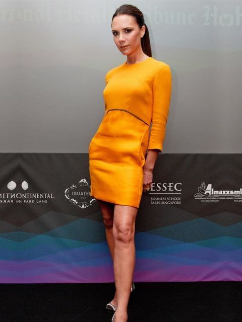 """<p><a href=""""http://www.elleuk.com/news/star-style-news/victoria-beckham-is-pregnant%21"""">Victoria Beckham</a> in one of her <a href=""""http://www.elleuk.com/catwalk/collections/victoria-beckham/spring-summer-2011/review"""">SS11 designs</a> at the International"""
