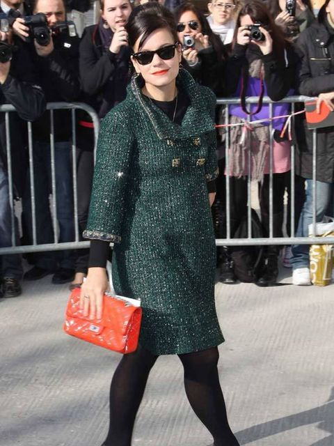 """<p><a href=""""http://www.elleuk.com/starstyle/style-files/%28section%29/lily-allen/%28offset%29/12/%28img%29/338898"""">Lily Allen</a> wearing a <a href=""""http://www.elleuk.com/catwalk/collections/chanel/"""">Chanel</a> coat and handbag in Paris, March 2011</p>"""