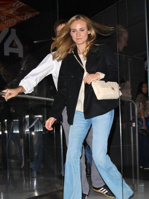 "<p><a href=""http://www.elleuk.com/starstyle/style-files/%28section%29/diane-kruger"">Diane Kruger</a> teaming her flared jeans with a <a href=""http://www.elleuk.com/catwalk/collections/chanel/"">Chanel</a> handbag and <a href=""http://www.elleuk.com/starstyl"