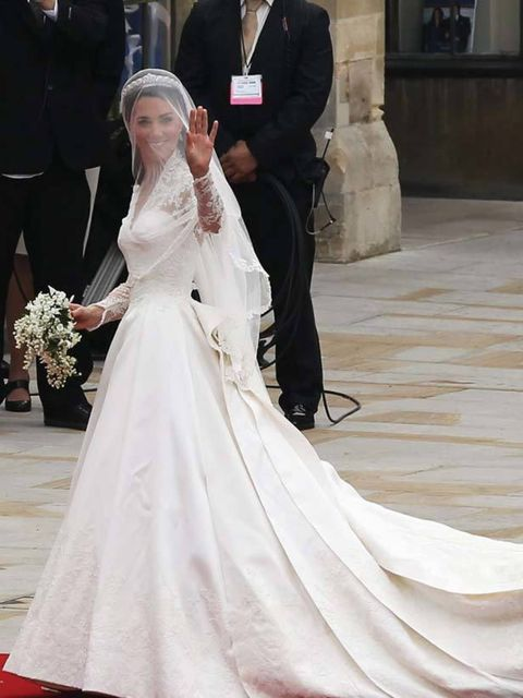 "<p><a href=""http://www.elleuk.com/starstyle/style-files/(section)/kate-middleton"">Kate Middleton</a> in a white lace gown with train, made by <a href=""http://www.elleuk.com/catwalk/collections/alexander-mcqueen/autumn-winter-2011/review"">Sarah Burton for"