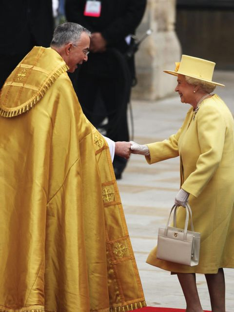 <p>The Queen wearing a goegoues yellow Angela Kelly outfit</p>