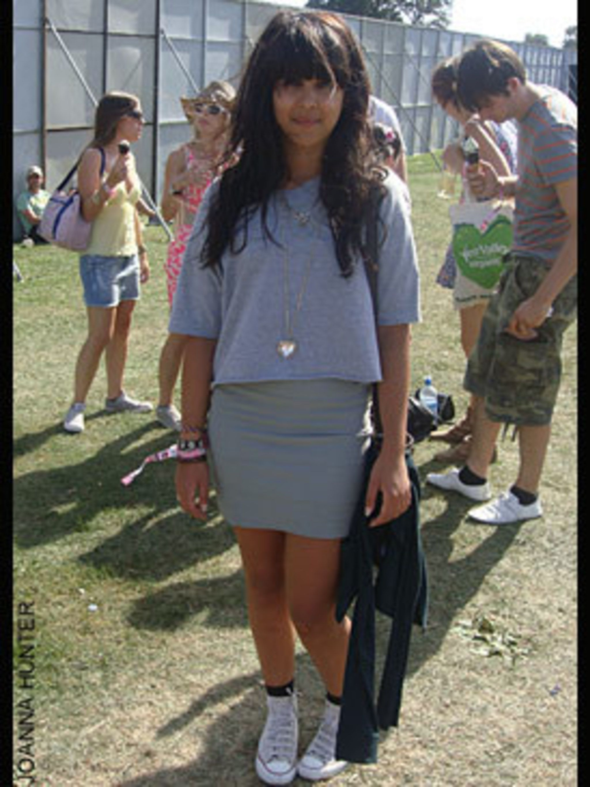 <p>Yasmin Uddin a 19 year old student from Chelmsford is wearing a customised T-shirt, Necklace from H&M, Skirt from Topshop, Converse trainers and Bag from Accessorize.</p>
