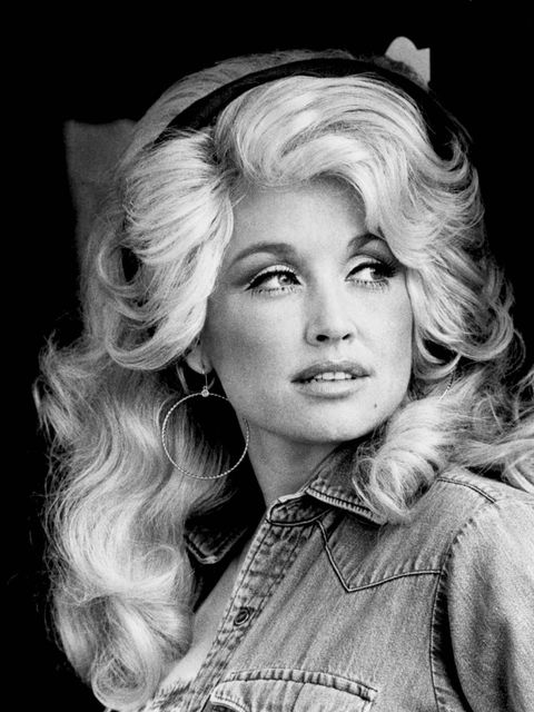 <p>'I always wanted to be prettier,' Parton has said of her teenage self. 'I got to fixin' myself up. I wanted my clothes tight, my make-up bright, my nails long, my lips red. I got into it.'</p>