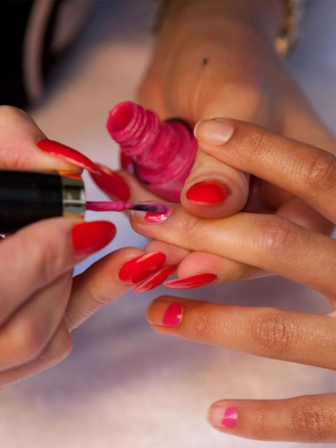 """<p>Next paint a third of your nail starting at the base at a curved angle using Revlon Nail Enamel in Fuchsia Fever, £6.49 at <a href=""""http://www.boots.com/en/Revlon-Nail-Enamel_33582/"""">Boots.</a></p>"""