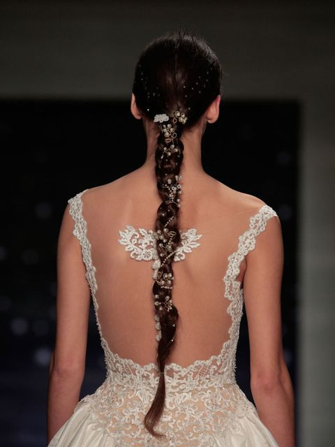 Uber-long braids were made opulent with pearls, crystals and lace at Reem Acra