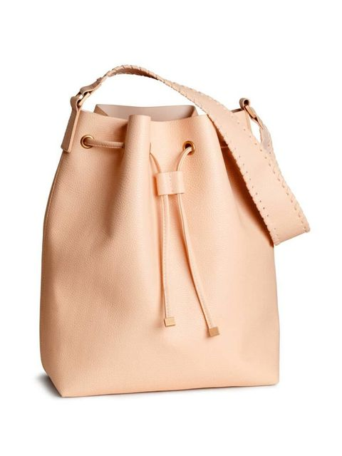 """<p>This season's it-bag is the bucket, and the high street has some of the best around.</p>  <p><a href=""""http://www.hm.com/gb/product/88461?article=88461-A"""" target=""""_blank"""">H&M</a> bag, £19.99</p>"""