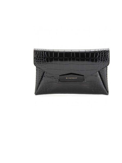 "<p>Givenchy clutch bag, £695 at <a href=""http://www.harveynichols.com/womens/categories-1/designer-bags/clutches/s419050-large-leather-clutch.html?colour=BLACK"">Harvey Nichols</a></p>"