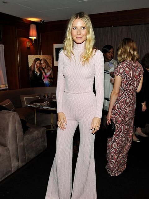 Gwyneth Paltrow wore an Emilia Wickstead bodysuit and highwaisted flared trousers from the Autumn/Winter 2016 Collection to attend the Hollywood Reporter and Jimmy Choo Power Stylist's Dinner in Los Angeles on 15th February 2016.
