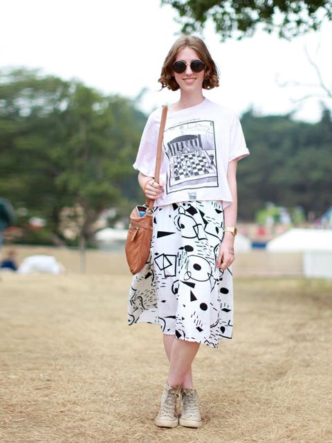 <p>Hanna Banks wears vintage t-shirt, Urban Outfitters skirt, with her Mum's bag and vintage sunglasses.</p>