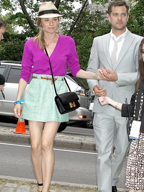 <p>Diane Kruger looking gorgeous in summer brights and a fedora </p>