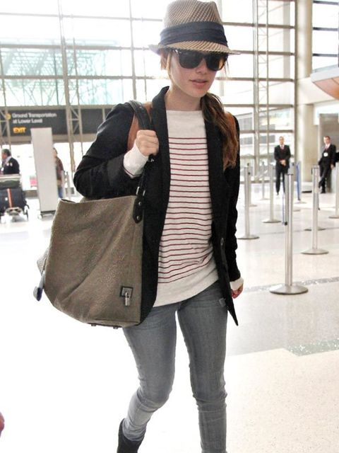 <p>Rachel Bilson looking chic in a stripe T-shirt and fedora</p>