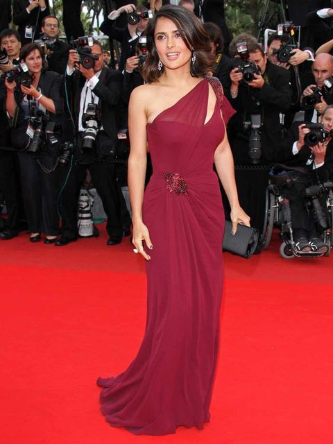 70caa76b78c <p>Salma Hayek wears a one shoulder Gucci gown to the premiere of '