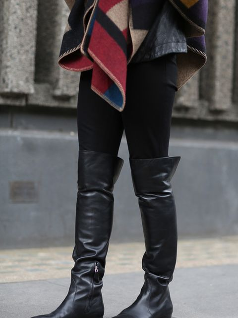 <p>Lorraine Candy - Editor-in-Chief</p>  <p>Burberry blanket and Prada boots.</p>