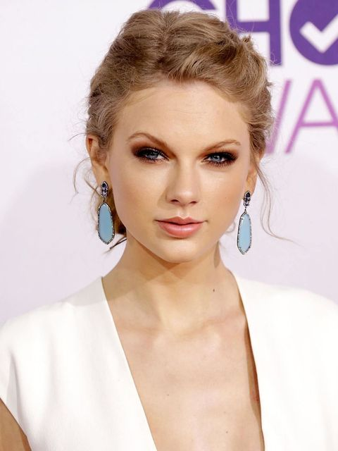 """<p><a href=""""http://www.elleuk.com/star-style/celebrity-style-files/with-golden-locks-of-hair-tumbling-around-her-shoulders-and-from-elie-saab-to-valentino-and-everything-in-between-see-all-of-taylor-swift-s-greatest-style-moments"""">Taylor Swift</a> at the"""