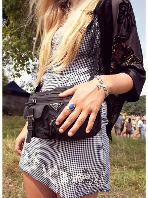 Stella Rozenbroek-Vinken wears Prada bag, vintage dress and kimono, elephant bracelet and Lapis Lazuli ring from Brighton pier.