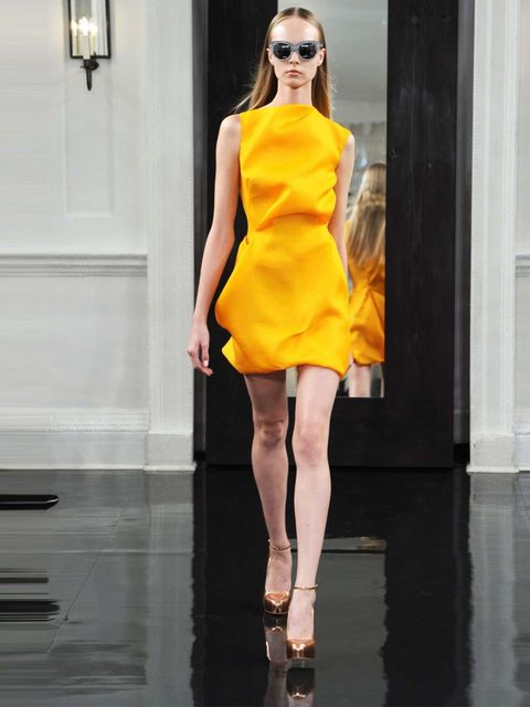 "<p><a href=""http://www.elleuk.com/catwalk/designer-a-z/victoria-beckham/spring-summer-2011/collection"">SS11</a></p><p>Such a gorgeous colour! Such a pretty dress! This is a colour that you would normally only wear with tanned skin in summer but here the m"