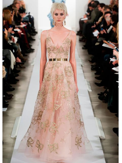 """<p><a href=""""http://www.elleuk.com/catwalk/designer-a-z/oscar-de-la-renta/autumn-winter-2014"""">Oscar de la Renta</a>, a/w 2014</p><p>This soft pink confection with gold glitter bows is a real statement piece. (Not that we'd expect any less from OdlR.)</p><p"""