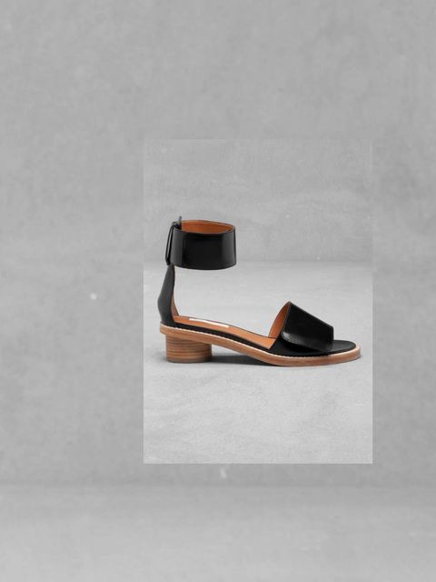 """<p>A pair of simple black leather sandals with this season's low stacked heel will update any outfit. This quietly elegant style is a great match for a bold statement skirt... <a href=""""http://www.stories.com/Shoes/Heels/Block_heel_sandals/582750-563108.1"""""""