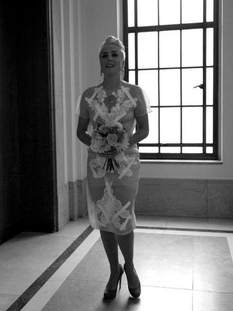 <p>My wedding dress was actually a two-piece skirt and top by Christopher Kane (SS13) in acid yellow with white lace applique, crystals and cellotape all over it.</p>  <p>The shoes were turquoise suede concealed platform pumps by Nicholas Kirkwood – a st