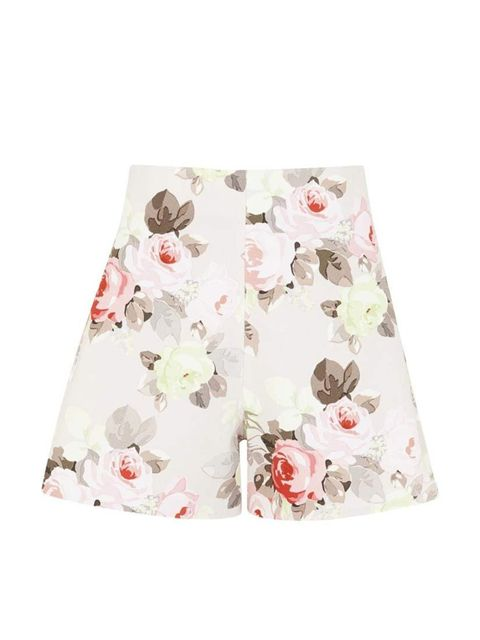 """<p>Downplay girly florals with a denim shirt or white tee.</p><p>Carven shorts, £260 at <a href=""""http://www.harveynichols.com/90373-floral-a-line-twill-shorts/"""">Harvey Nichols</a></p>"""