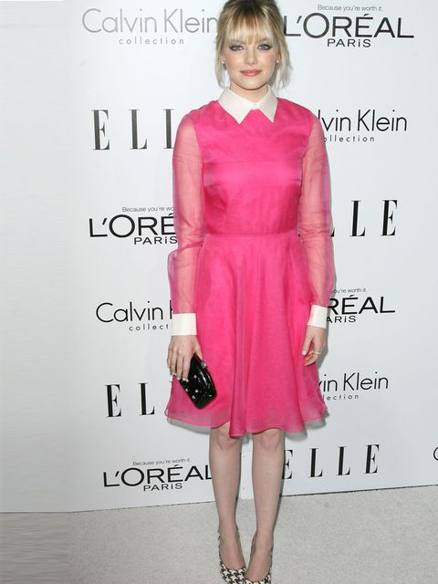 <p>Emma Stone in a pink Valentino dress and clutch Ferragamo heels, Neil Lane earrings, and Irene Neuwirth rings.</p>