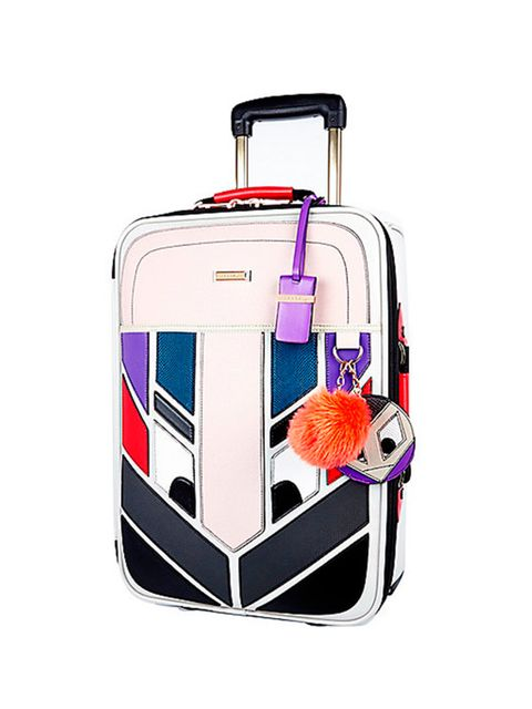 """<p>Fashion Assistant Felicity Kay is packing her summer essintials in this cute suitcase.</p>  <p><a href=""""http://www.riverisland.com/women/bags--purses/make-up-bags--luggage/grey-monster-wheelie-suitcase-671825"""" style=""""font-size: 13px; line-height: 1.6;"""