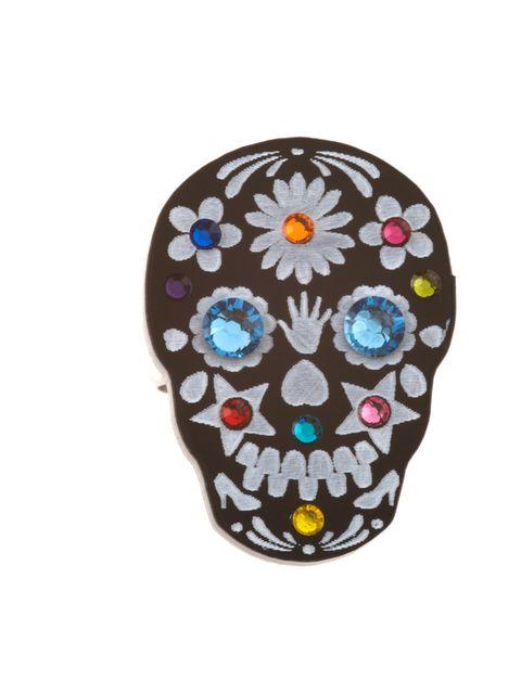 "<p><a href=""https://www.tattydevine.com/sugar-skull-ring-black.html"">Tatty Devine</a> embellished skull ring, £24</p>"
