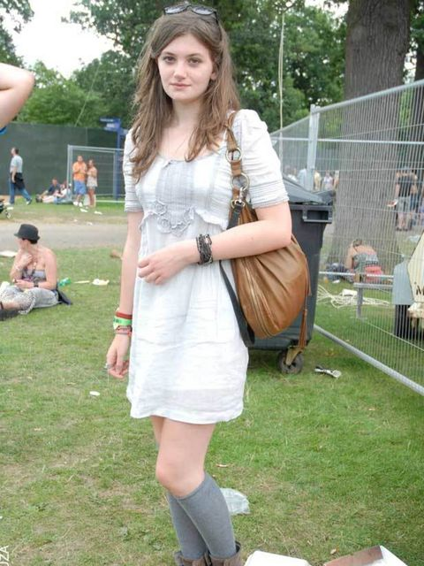 <p>Rosie, 16, Student. Zara dress, River Island boots, mum's bag.</p>