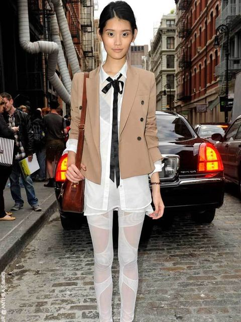 <p>Ming Xi, 20, Model. Vintage jacket & leggings. </p>